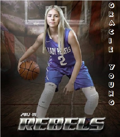 Posed image of girls high school basketball player for Gracie Young, Johnson Bayou high school, Louisiana, in blue LADY REBELS, #2 uniform, dribbling a basketball.