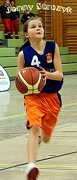 Picture of Jenny Strozyk, Herner TC U13 basketball player, going in for a basket, in a practice for a 2012 post-season All-Star game.