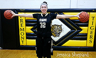 Image of Jessica Shepard, Fremont High School (Nebraska) basketball player, number 32, holding two balls showing wingspan.