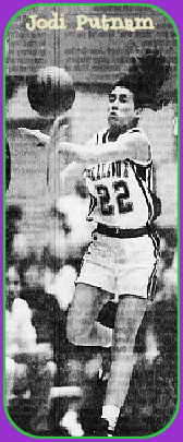 Image of state of Iowa's girl basketball player for Bellevue High School, #22, up in the air, passing the ball in a 3/6/1995 Class 1A playoff game. Photo by Bob Nandell, from The Des Moines Register, March 7, 1995, Des Moines, Iowa.