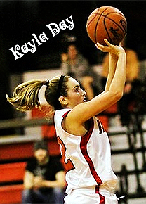 Kayla Day, Fairview High player, with pony tail, shooting basketball to the right.