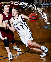 Laura Davidson, Greenwood High girls basketball player, #32 in white uniform, driving upcourt.