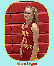 Image of California girls basketball player, Alexis Legan, in red uniform with yellow lettering, #13, in � pose.