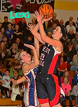 Lexi Gussert, Michigan girls basketball player on the Forest Park High School girls team, in 2013. Shown shooting to our left in blue uniform with big red stripe down side. Number 23.