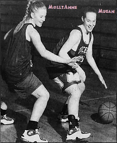Basketball playing sisters practicing against each other. MollyAnne Light on the lft, Megan Light on the right. Players on the Gloucester High School Lions (New Jersey). Image from the Courier Post, February 9, 1997, photo by Brian Porco