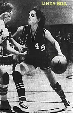 Image of Iowa girls basketball player, Linda Bill, Riceville High, number 45, dribbling the ball to our left, around Holly Byington, Nora Springs-Rock Falls High, the Cass 1A sectional final, 2/18/1982, a 58 to 51 win. From the Globe-Gazette, Mason City, Iowa, Feb. 19, 1982. Staff photo by Jeff Heinz.