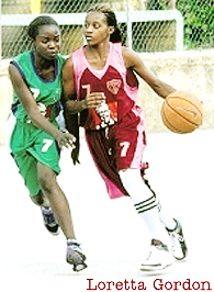 Loretta Gordon dribbling the ball against a defender, for the Spot Valley High School basketball team. Jamaica. From the Jamaica Observer.