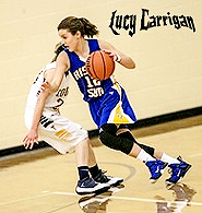 Image of Lucy Carrington, girls basketball layer for Rising Sun High School, driving with basketball, in blue uniform, #12.