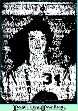 Image of Iowa girls basketball player for the Lenox High Tigerettes, in uniform number 34, vertical LENOX on shirt. From team photo in the Lenox Time Table, Lenox, Iowa, February 25, 1965.