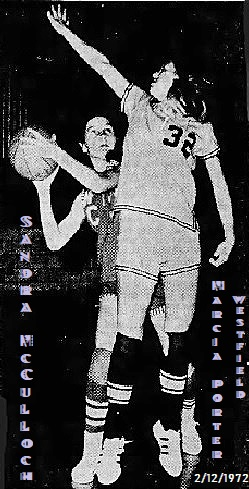 Image of a state of Iowa girls basketball game from 2/12/1972, a sectional game at Heelan High, Sioux City, final score Westfield HS 82 - Woodbury Central High 73. We see Woodbury's Sandra McCulloch peaking around defender, Marcia Porter, #32, Westfield guard with hand n air jumping to block a shot attempt.  Ms. McCulloch has ball in hand, big C on uniform jersey, looking to shoot one of her her 65 pts, that night. From the Sioux City Journal, Sioux City, Iowa, Feb. 13, 1972; photo by McCarty, staff photographer.