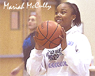 Mariah McCully close-up, with basketball.
