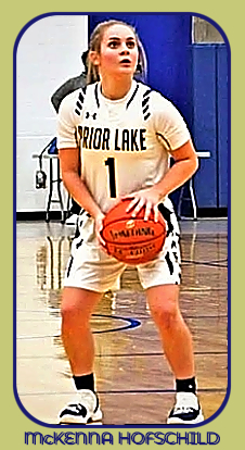 Image of Prior Lake High School girls basketball player, in Minnesota, shooting a foul shot in game, December 1, 2018, when she scored 63 points. White uniform #1.