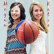 Photo of basketball playing sisters, Kathie and Megan O'Neal, back to back, in street clothes, but each grips the same basketball. Megan, the brunette sister to our left, hold the basketball with her left arm. Kathie, to our right, the blonde sister has her right arm outstreched tho grip the basketball, being presented towards the camera. Kathie wears a whote patterned dress, Megan a multi colored sweater dress. I guess.