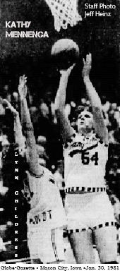 Image of Iowa girls basketball player, Kathy Mennenga, #54, Hampton High, shooting under basket over Lynn Childress of Humboldt High. One of her 48 points in the January 30, 1981 game. From the Globe-Gazette, Mason City, Iowa, January 31, 1981, staff photo by Jeff Heinz.