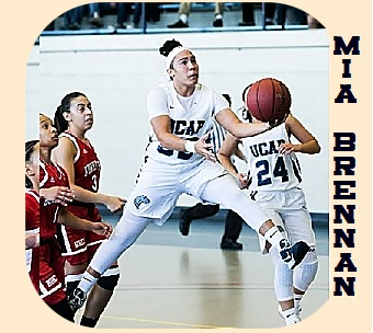 Women's college basketball player, Mia Brennan, UConn-Avery Point, going in for an underhand scoop. In air legs akimbo..