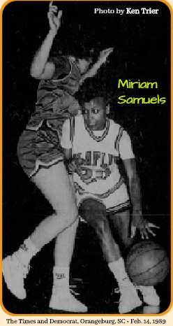 Image of Miriam Samuels, Claflin College driving around a tall Morris College player, in the February 13, 1989 game in which she scored 50 points. Wearing uniform #20. From The Times and Democrat, Orangeburg, South Carolina, 2/14/1989. Photo by Ken Trier.