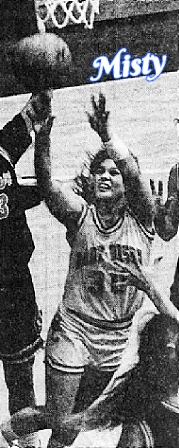 Image of Indiana girls basketball player for Benton Central High School, under the basket going for the ball. Photo from the Journal and Courier, Lafayette, Indiana, January 22, 1992. Photo by Jose R. Mendez.