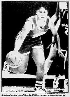 Image of Monika Williams, Bradford Tornado basketball player, in action, dribbling the ball up court. From The Gainsville Sun, Gainsville, Florida, JAnuary 3, 1991. Photo by DeVon Havine.