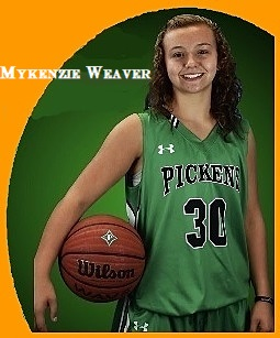 Image of Mykenzie Weaver, Pickens High School (Georgia) girls basketball player, in green uniform, number 30, posing with basketball held at her right hip.