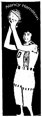 NAncy Hamilton, Corwith-Wesley (Iowa) High School Vikette, posing in uniform, holding basketball over her head, from The Kossuth County Advance, July 8, 1974.
