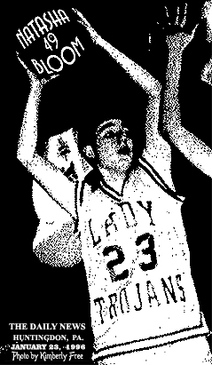 Picture of Natasha Bloom, Mount Union Lady Trojan basketball player, number 23, looking to pass the ball against the Huntingon High Bearcats, in a January 22, 1996 game at Huntingon, won by the Lady Trojans, 57 to 50. Ms. Bloom scored 51 points. Photo by Kimberly Free, from The Daily News, Huntingdon, Pennsylvania, January 23, 1996.
