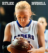 Rylee Nudell, Maple Valley High Raiders (North Dakota), holding basketball at foul line.