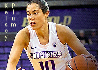 Image of Kelsey Plum, NCAA career scoring record holder, University of Washington, in white HUSKIES uniform, driving with ball. Photo: Percy Allen, Seattle Times.
