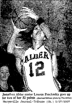 Lauren Prochaska scoring 2 of 52 points. Photo: Tim Miller, Marysville Journal-Tribune, Feb. 27, 2007.