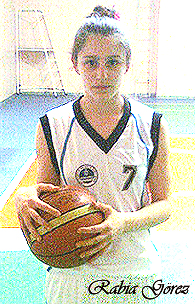Rabia Gorez, Derince Vocational Trade High School basketball player, Turkey. Pictured holding basketball, posing for camera, number 7 uniform.