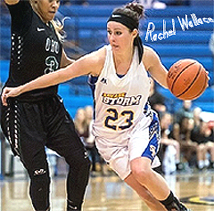 Rachel Wallace, Southeastern Oklahoma State University women's basketball player, number 23, in a Savage Storm white uniform, trying to dribble around a defender.