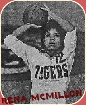 Image of Rena McMillon, Ely High girls basketball player (Florida), in white TIGERS uniform #12, holding basketball over her head. From the South Florida Sun Sentinel, Fort Lauderdale, Florida, May 6, 1987.