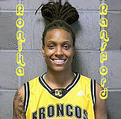 Portrait of Ronika Ronson, Olds College  (Alberta) women's basketball player, posing in yellow uniform with blue lettering: BRONCOS, the team's nickname.
