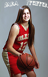 Posed image of Sara Pfeiffer, Olean High School girls basketball player. In red uniform, #12, dribbling ball.