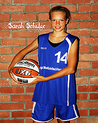 Image of Sarah Schulze, U15 basketball player for USC Magdeburg in Saxony-Anhalt, Germany. Posing with basketball against brick wall, in blue uniform, number 14.