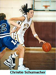 Image of Christie Schumacher, Milford High (Michigan) basketball player, bring the ball up the court