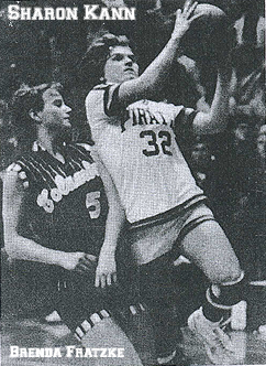 Guttenberg's 5-5 Sharon KAnn driving on Columbus guard Brenda Fratzke in a Class 2A Regional final. Date unknown, newspaper ubknown. Photo by Ken Schmith.