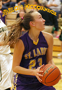 Shiloh McCormick, St. Labre Indian Catholic School (Montana) girls basketball player, #23 , going in for a shot, hair flying behind her. Billings Gazette.