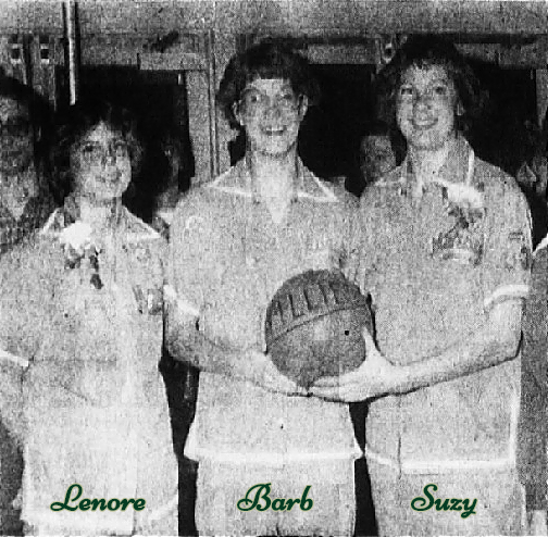 Image of three Shimkus sisters holding a basketball reading FILLIES, wearing sweats of the Marian Catholic High School girls basketball team. From left to right: Lenore, Barb and Suzy Shimkus. From The Daily American, Somerset, Pennsylvania, February 14, 1980.