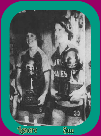 Reverse image of image shot into mirror. Cropped. Sisters and twins, Lenore and Sue Simkus, in Marian Fillies uniforms, holding trophies. From the Evening Herald of Dhenandoah-Ashland-Mahanoy City, Pottsville, Pennsylvaniam  February 5, 1980.