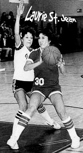 Black and white image of Laurie St. Jean, Putnam High (Connecticut) basketball player, number 30, with ball trying to get a shot or pass over a defender.