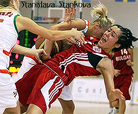 Image of game action, with Stanislava Stankova playing for the Bulgaria National team in 2009. Picture shows her falling backwards in rough play.