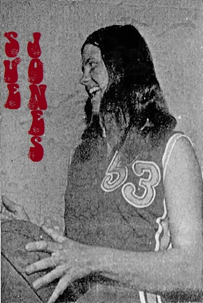 Image of Iowa High School girls basketball player, Sue Jones, of the Heelan High Crusaders team. Posing with basketball, in uniform number 53, in profile, facing to our left. From the Sioux City Journal, Sioux City, Iowa, December 15, 1974.