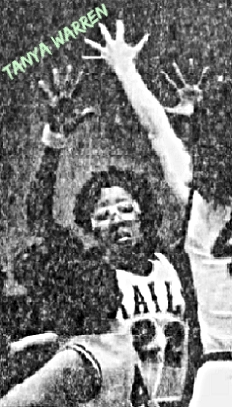 Image of Iowa girls basketball player Tanya Warren on defense in same game she scored 47 points for the Lincoln High School (Des Moines). Guarding against Waukee in her number 22 'RAILS' jersey. From The Des Moines Register, Des Moines, Iowa, February 18, 1983.