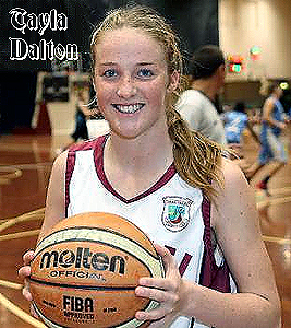 Image of Tayla Dalton, Carmel College (New Zealand) girls basketball player, in white Carmel uniform, holding basketball. SHANE WENZLICK/PHOTOTEK
