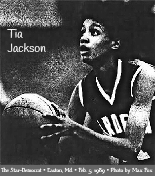 Image of Tia Jackson, Mardela Springs High School girls basketball player, in dark uniform, shooting a foul shot to our left. From  The Star-Democrat, Easton, Maryland, February 5, 1989. Photo by Max Fox.