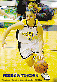 Image of Monica Tokoro, Cal State- L.A. eomen's basketball player, #21, dribbling ball upcourt.