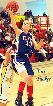 Tori Tucker, Floyd High (New Mexico), number 13, going up for a lay-up.
