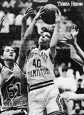 Photo of Trisha Heiden, girls basketball player for Northeast Hamilton High School of Blairsburg, Iowa, in the Class 1A State tournaent game of 3/7/1995. In uniform #40, shooting over Norma Leo of Panorama of Panora, #55. Photo by Bob Nandell, from The Des Moines Register, Des Moines, Iowa, March 7, 1995.
