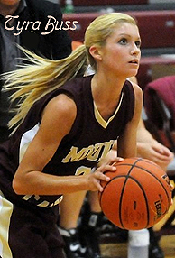 Tyra Buss, number 3 on Mount Carmel basketball team, shooting a foul shot.