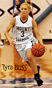 Tyra Buss, Mount Carmel (Ill.) basketball player, number 3, dribbling upcourt.